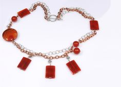 Carnelian gemstones dangling from copper and non-tarnish sterling silver chain. Carnelian, Sterling Silver Chains, Dangles, Fine Jewelry, Beaded Necklace, Jewelry Design, Copper, Gemstones, Beaded Collar
