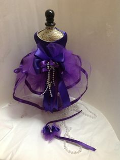 Dog dress, Beautiful PURPLE satin Dog harness dress with ribbon and tulle. Comes with matching DOG GROOMING HAIR BOW, MADE FOR SMALL DOGS, TEACUPS, MINIATURES, FERRETS, CATS, PETS. She'll be the BELL OF THE BALL. PAGEANTS, TALENT SHOWS, WEDDINGS, SPECIAL OCCASIONS, OTHER COLORS AVAILABLE. Please visit out store at www.lavenderscloset.webstoreplace.com   For more info or Special orders email us at lavenderscloset4pets@gmail.com Also visit us on Instagram at @lavenders_closet Thank you Girl Dog Clothes, Dog Clothes Patterns, Pet Fashion, Purple Satin, Dog Costumes, Dog Dresses, Dog Harness, Handmade Design, Dog Grooming