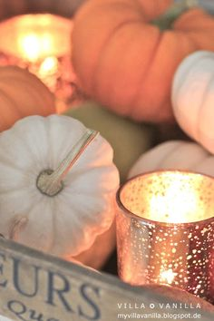 Beautiful autumn decorations, I love the candle holders.