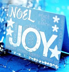 Silver stickers in different sizes and fonts combine to make a festive card for the holidays./