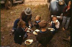 Family eating barbecue at the New Mexico Fair, 1940