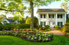 Vintage farm with green front yard