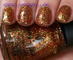 China Glaze - Hunger Games - Electrify  €4.99 EUR  Colour: clear base Finish: red and gold glitter Coats suggested: 2 Size: 14 ml   Pictured with 2 coats.   Please note colours may vary slightly due to monitor s