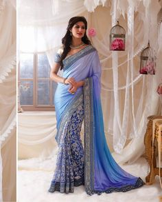 Blue sari with thread embroidered pleats   1. Blue satin net embroidered sari2. Comes with matching unstitched blouse material
