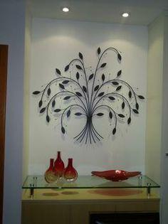 Objetos artesanais fabricados em ferro dão charme à decoração. Na foto, enfeite de parede Cecy, da Lacordaire Resende - Lacordaire Resende/D...