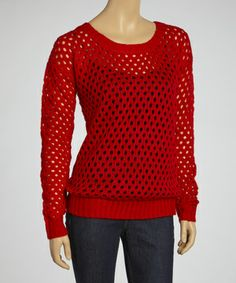An updated twist on the classic sweater, this breezy option flaunts an on-trend loose-knit design that's perfect for layering with leggings or favorite jeans.