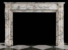 An antique marble Louis XVI style fireplace mantel