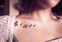 Lovely and simple music tattoo. I wouldn't get it there but music tats always get me