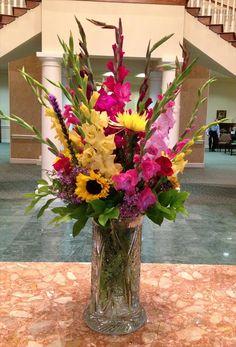Bright Flower Buffet Arrangement: Gladiolas, Sunflowers, Roses: www.darlingflowers.net