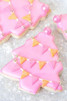 DIY tutorial of Pink Christmas Tree Cookies with Fondant Pennants.