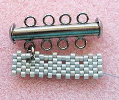 Seed bead jewelry How to do peyote to leave holes for attaching a bar closure.~ Seed Bead Tutorials Discovred by : Linda Linebaugh I was just looking for a solution to attach a beaded piece to a metal loop component with jump rings.How to attach slide sid Seed Bead Tutorials, Seed Bead Patterns, Beaded Jewelry Patterns, Beading Tutorials, Bracelet Patterns, Beading Patterns, Beading Ideas, Beading Supplies, Seed Bead Bracelets