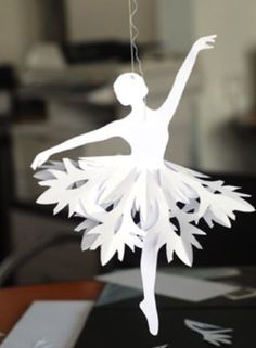 """Paper Ballerina Snowflakes Tutorial {pretty for an ornament} """"These DIY ballerina snowflakes are a lot easier than they look. After printing out the ballerina templates and following the snowflake tutorial below, all you will need are a pair of scissors, paper, and thread for hanging..."""""""