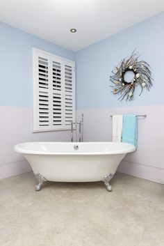Cozy, comfortable, old school tub - the blue with white color coding brings an ease to this perfect little bathroom. www.PrestigePaints.com