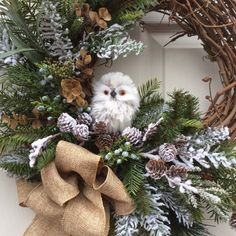 HOLIDAY SALE- 15% off-Christmas Wreath-Holiday Wreath-Winter Wreath-Natural Christmas-Owl Wreath-Natural Wreath-Designer Decor-Burlap Wreath-Woodland Wreath This lovely woodland wreath is perfect for display throughout the entire winter season. Natural looking Douglas fir, snow covered noble fir boughs, eucalyptus and myrtle set the stage for an adorable white snowy owl. He sits in a nest of fir branches, sprigs of juniper, and snow covered branches of miniature pine cones. A glittery…