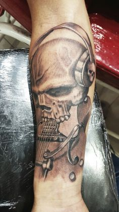 Black and gray skull guitar tattoo