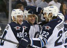 Devin Setoguchi #40 Olli Jokinen #12 and Chris Thorburn #22 Winnipeg Jets