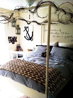 oh my this has so many elements i love...lettering on wall...anchor + twine of twigs  with lanterns - all boy ...all wonderful