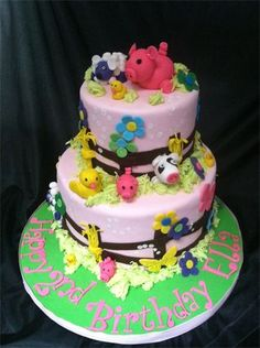 "Two tiered cake celebrating a ""2nd"" birthday for a little girl who loves farm animals!"