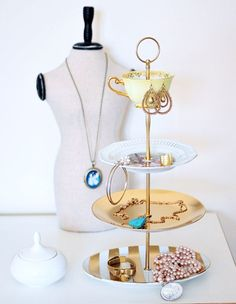 Order some cake stand fittings online and put together with vintage china and gold spray paint for a gorgeous, personalized jewelry or cake stand.