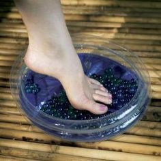 """Add marbles to your foot soak for a nice self foot massage! Just roll your feet over the marbles. Author says, """"A foot massage stimulates blood flow and soothes tired muscles, both of which are vital for your well-being."""""""