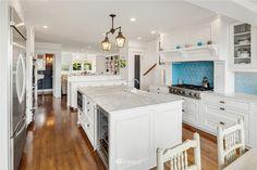 5736 64th Ave NE - Photo 13 of 39 Tudor Kitchen, Windermere Real Estate, Area Units, Hardwood Floors, Flooring, Half Baths, Stainless Appliances, Walk In Closet, Quartz Countertops