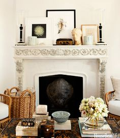 The mantel and coffee table display designer Mark D. Sikes's passions: boxes, books, and art from China and Paris flea markets.