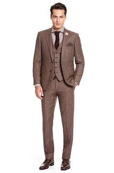 groom wears a tan suit with brown tie and the groomsmen wear these ...