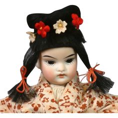 This little gem of a doll is so delightful in so many ways.  Let me count the ways:  Firstly, she is so small, that she will be able to slip into your
