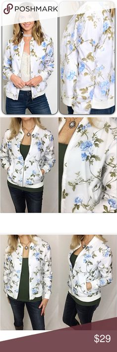 "Small Floral Bomber Jacket This bomber jacket adorned with baby blue roses with olive leaves is absolutely gorgeous. Satin-like lining with chiffon overlay. Silver hardware & off-white trim. Wear zipped or unzipped...so versatile. Two front pockets. 100% Polyester Looks great with jeans or shorts!  Small 2/4/6 Bust 32-34-36"" Length 22"" Jackets & Coats"