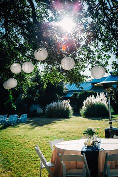 Intimate Bed and Breakfast Wedding. Wedding decor outdoor with hanging lanterns. #weddingdecor #lanterns #outdoorwedding