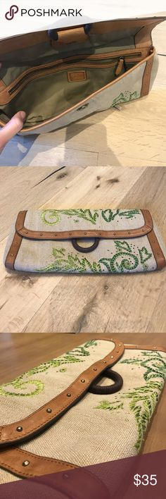 Cole Haan Handbag with with embroidery Beautiful natural linen clutch with green stitching & leather details. It can carry a lot for a clutch and has an enclosed zipper as well. Perfect condition- only used once. Comes with dust bag. Cole Haan Bags Clutches & Wristlets