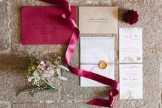 Burgundy and white invitations with lovely ribbon and flowers