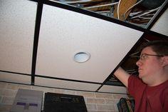 Installing recessed lighting trim Drop Ceiling Basement, Drop Ceiling Lighting, Ceiling Lights, Installing Recessed Lighting, Recessed Lighting Trim, Dropped Ceiling, Ceiling Tiles, Light Installation, Diy