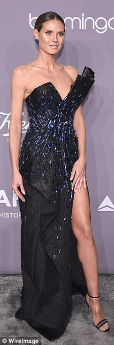 Leggy: They say that if you've got it, you should flaunt it and that's exactly what models Ashley Graham, Olivia Culpo and Heidi Klum did Wednesday night in New York at the 2018 amfAR gala