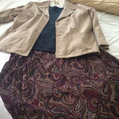 Beautiful 4 piece back to school outfit Beautiful 4 piece back to school outfit. Elastic waist skirt approx knee length. Cream colored short sleeve button up shirt. Hunter green short sleeve pull over sweater. Long sleeve corduroy jacket. All XL-2X. The skirt is a XL. Liz Baker Dresses