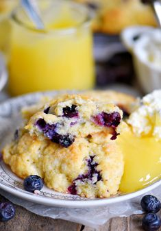 Lemon Blueberry Scones - a delightful addition to any breakfast or brunch. Fresh blueberries & loads of lemon zest add an irresistible freshness to these easy to make scones. Serve w/lemon curd & cream for an afternoon tea you will love! // Mom On Timeout Brunch Recipes, Dessert Recipes, Scone Recipes, Brunch Food, Blueberry Scones Recipe, Fruit Scones, Blueberry Recipes, Lemon Curd, Recipes
