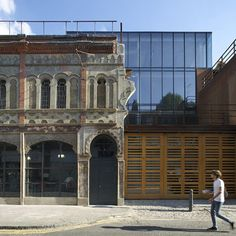 London architects Buckley Gray Yeoman converted a fire-damaged former market hall in Shoreditch into Corten-clad university offices.