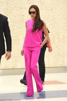 Pretty in pink: Victoria Beckham became the perfect model for her own range when she stepped out in a fuschia coorindate in New York on Tuesday