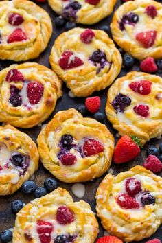 This Cream Cheese Danish recipe is so easy to make. The cheese danish filling tastes just like cheesecake and the fresh berries and lemon glaze add a bright pop of flavor. This puff pastry recipe always disappears fast! Learn how to make cheese danish with this video tutorial.