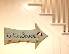 Beach arrow sign & rack in a California home.