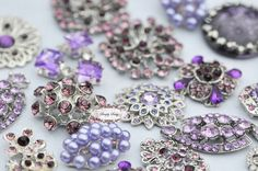 10pc Lavender Purple Assorted Rhinestone Flat back Embellishments DIY Brooches Crystal Buttons Wedding Bouquet Favors Invitations Bling. $17.50, via Etsy.