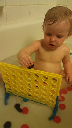 Cheap and Easy fine motor activity for the bath. Just add the Game Connect Four. My 1 yr old loves it! (Need to check garage sales)
