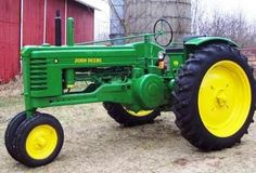 Old Tractor  John Deere…because we have a frame now and need a tractor and the husband is from Wisconsin!