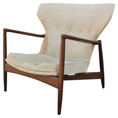 Rare Sculptural Wingback Lounge Chair by Ib Kofod-Larsen | From a unique collection of antique and modern lounge chairs at https://www.1stdibs.com/furniture/seating/lounge-chairs/