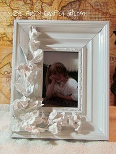 Faux Porcelain Frame Tutorial   For this project I used:    Plaster of Paris  Silk flowers from the Dollar Store  A thrift store frame  Hot ...
