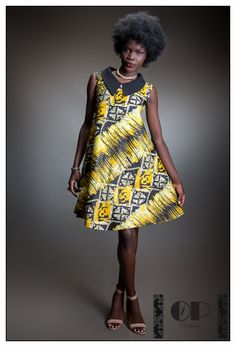 This simple and classy African print dress with chiffon collar is a must have. I… This simple and classy African print dress with chiffon collar is a must have. It can be worn for many occasions including professional looks, casuals and party. African Dresses For Women, African Print Dresses, African Print Fashion, African Attire, African Wear, African Fashion Dresses, African Women, African Prints, Ghanaian Fashion