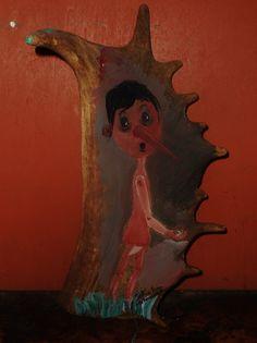 Pinocchio su corno di Daino trovato.