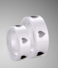 Couple's white ceramic wedding band set with engraved poker heart shape