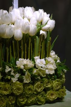 Elegant green and white centerpiece of tulips and jade roses.....lovely for spring!  Preston Bailey