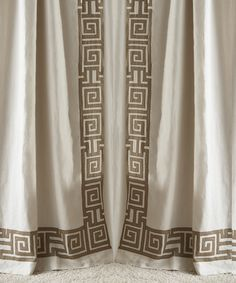 large grosgrain makes a greek key trim on the leading edge of